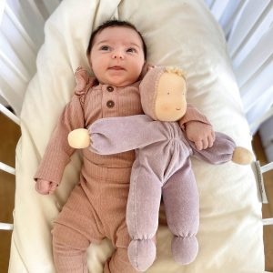 Baby with Grimm's purple Waldorf doll handmade of natural materials